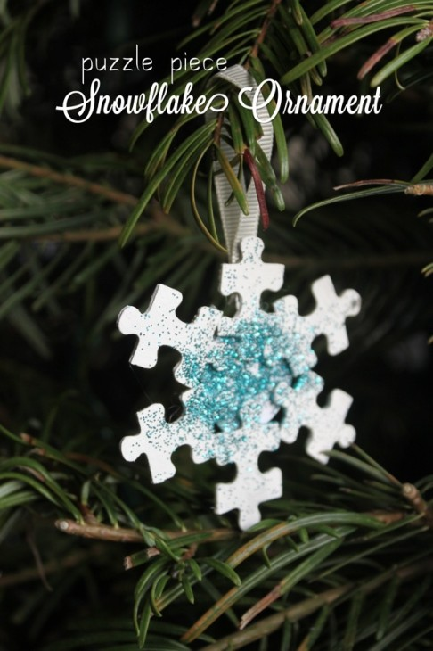 snowflake puzzle piece craft 486x730 Puzzle Piece Crafts for All Seasons!